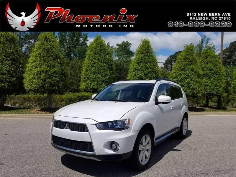 2011 Mitsubishi Outlander SE AWD 4dr SUV for sale by dealer